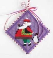 Santa with Penguin Ornament