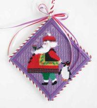 Santa with Penguin Ornament