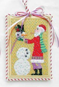 Santa Building a Snowman Ornament