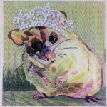 The hamster has her tiara!